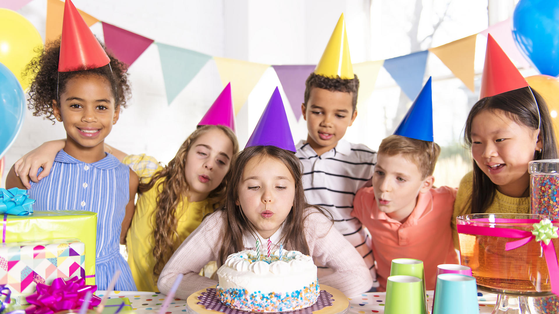 A group of children at birthday party at home